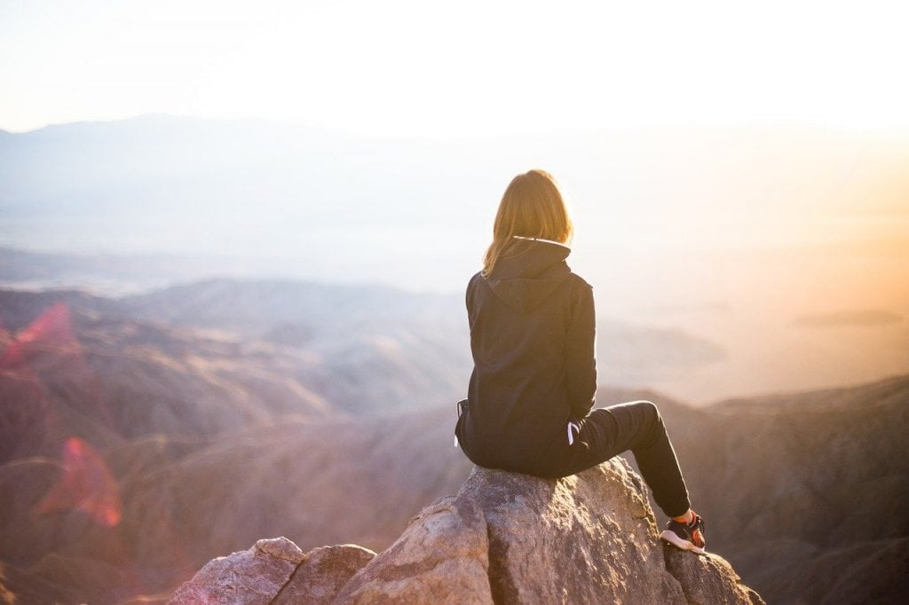 woman sitting on mountain- names that mean solitary
