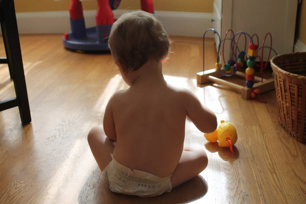 how to change a two year olds diaper- use toys as a distraction!